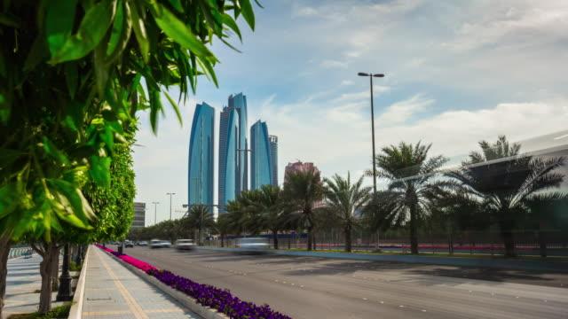 sunny greens famous abu dhabi traffic road emirates towers panorama 4k time lapse uae video