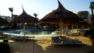 Sunny Hotel Resort with Blue Pool, Palm Trees and Sunbeds in Egypt video