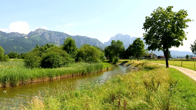 Sunny landscape with river in the Bavarian Alps video