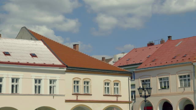 Sunny medieval Renaissance square. View from arcade to old houses. video