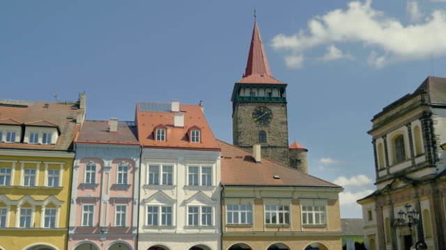 Sunny medieval Renaissance square with stone tower and clock. video