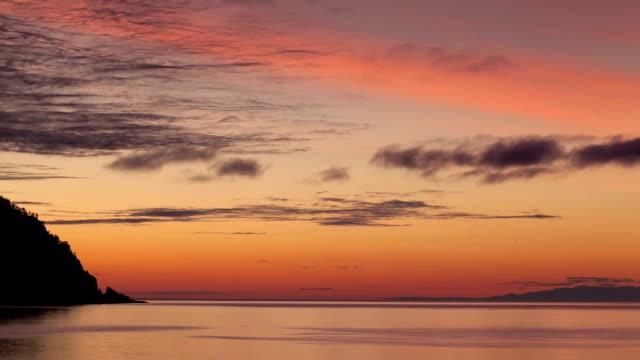 Sunrise above lake. Time lapse. video