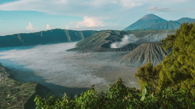 Sunrise at Mount Bromo volcano, the magnificent view of Mt. Bromo located in Bromo Tengger Semeru National Park, East Java, Indonesia. Zoom in camera video