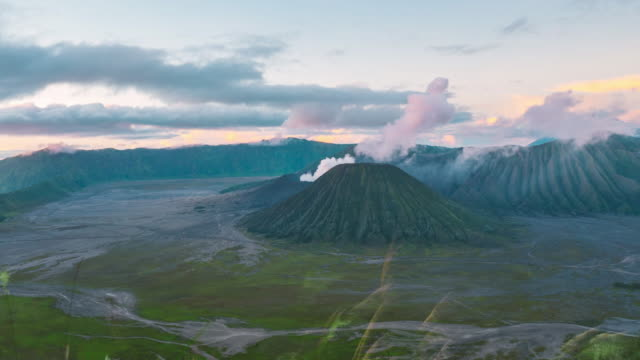 Sunrise at Mount Bromo volcano, the magnificent view of Mt. Bromo located in Bromo Tengger Semeru National Park, East Java, Indonesia. Zoom in view video