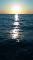 Sunrise at sea, loopable, vertical video
