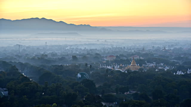Sunrise behind the mountains at Mandalay hill in Myanmar, time lapse. video