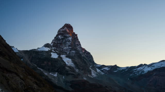 Sunrise light over the elegant Matterhorn or Cervino summit (4478 m), italian side, Valle d'Aosta. Time lapse 4k video. video