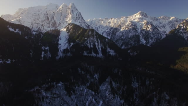 Sunrise Lighting on Aerial Floating to Big Snow Covered Peaks of Mount Index, Washington video