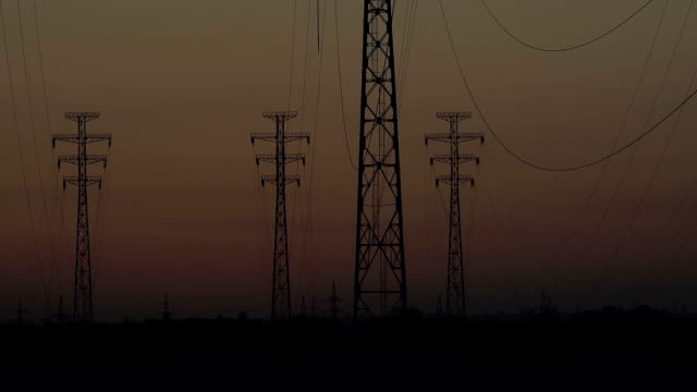 Sunrise on a background of a high-voltage line video