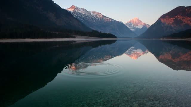 sunrise on the lake plansee, tirol, austria video