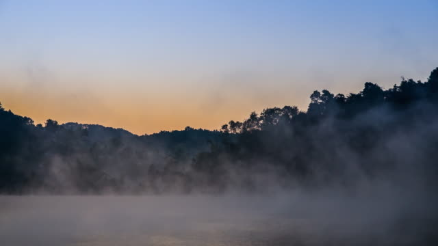 Sunrise on the lake reflection and mist on the lake , 4k (UHD) video