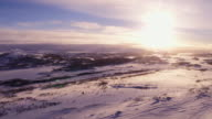 Sunrise on top of snowy mountain in Norway video
