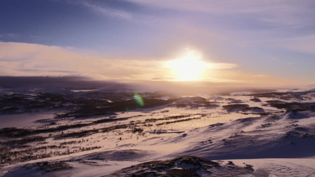 Sunrise on top of snowy mountains in Norway video