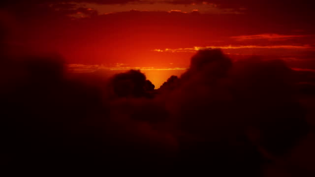 Sunrise over clouds. Orange sky with fluffy clouds. Shiny sun. video