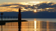 Sunrise over Harbor With Majestic Lighthouse, Time Lapse video