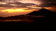 Sunrise over Lake Batur, Volcano Agung and Abang on the background. Bali video