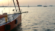 sunrise over the coast through the rigging of a sailing yacht video