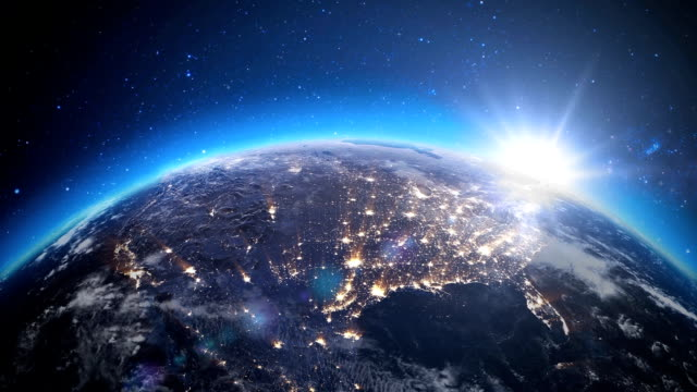 Sunrise over the earth seen from space.Close up of USA zone with night time and sunrise. video