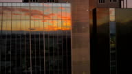 AERIAL: Sunrise reflection in big office building video