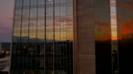 AERIAL: Sunrise reflection in glass skyscraper video