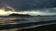 Sunrise time lapse with dark clouds above Dunk Island video