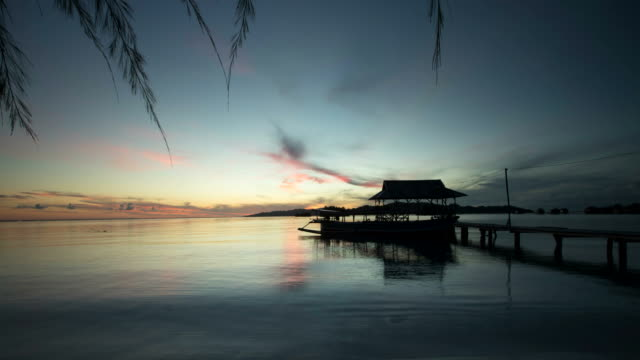 Sunrise time lapse with jetty in Sulawesi Indonesia video
