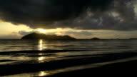 Sunrise with dark clouds above Dunk Island in mission beach, Queensland, Australia video