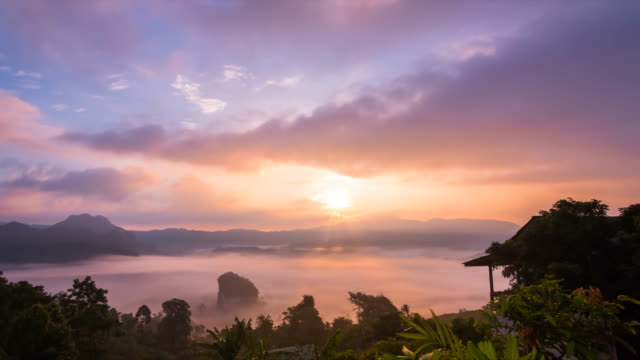 Sunrise with mist and clouds moving, Phayao Thailand. video
