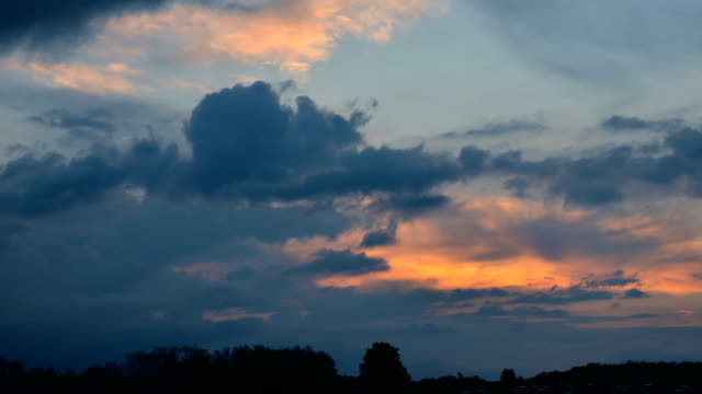 Sunset and moving clouds video