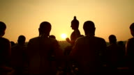 Sunset and silhouette big buddha statue video