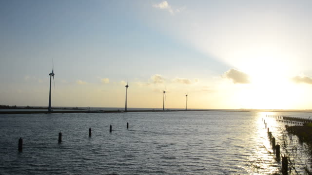 Sunset and wind turbines video