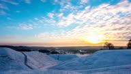 Sunset and winter landscape,  time-lapse video