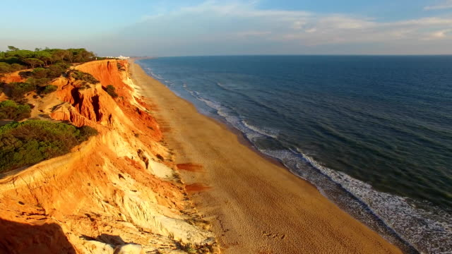 sunset at coast cliffs beach aerial Portugal Algarve aerial view video
