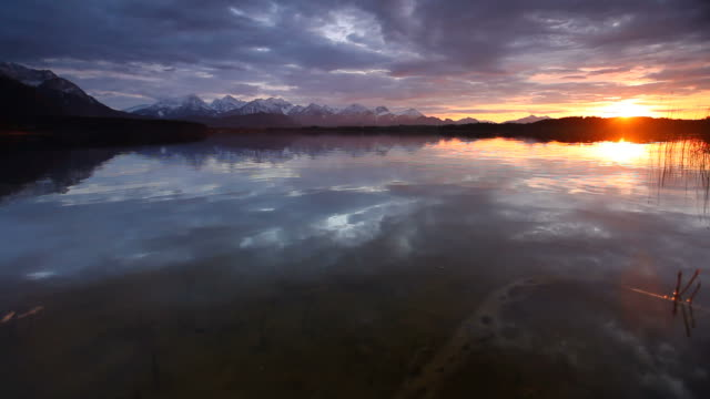 sunset at lake bannwaldsee in bavaria - germany video
