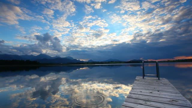 sunset at lake hopfensee - bavaria -germany video
