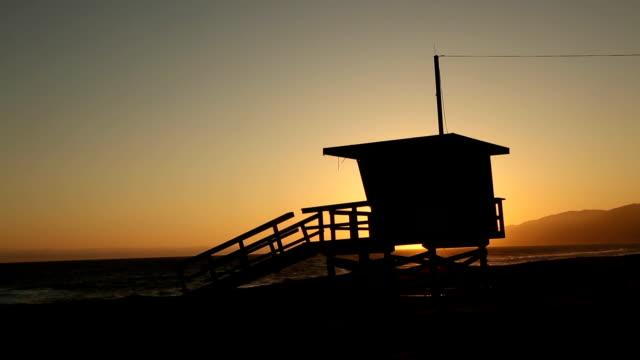 Sunset Behind Lifeguard Tower, Malibu.  California. video