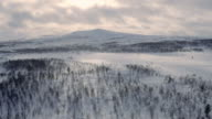 Sunset behind snowy mountain in Norway. Dramatic clouds video