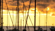 Sunset behind the yachts at marina in Bar city, Montenegro video