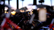 Sunset Close-Up Parked Bikes Active People in the Background video