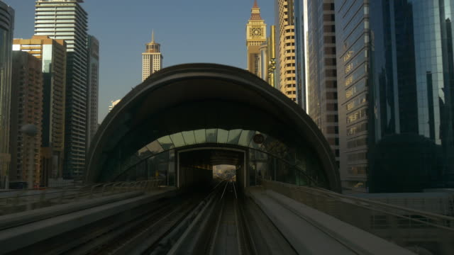 sunset dubai famous metro ride downtown front panorama 4k united arab emirates video