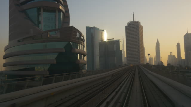 sunset dubai famous metro ride road trip downtown front panorama 4k united arab emirates video