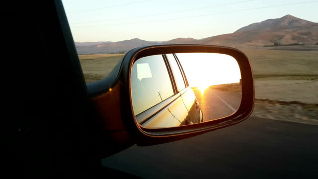 Sunset in a rear view mirror video