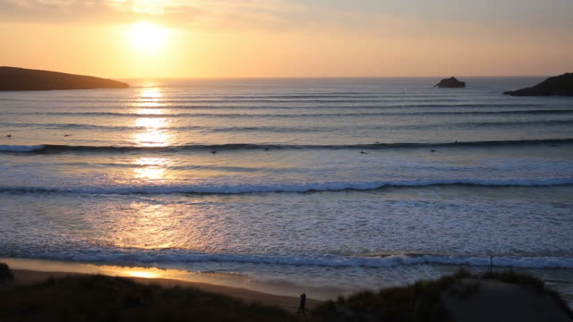 Sunset in Cornwall with surfers Crantock beach near Newquay video