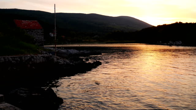 Sunset in the Bay of Kotor. Montenegrin sunsets. Sunset over the video