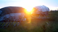 Sunset in the tundra. Sleds in the sunshine. video