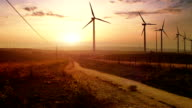 Sunset landscape with wind turbines video