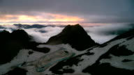 Sunset of High Snowy Tops of Mountains with Clouds Timelapse. Kavkaz region video