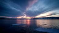 Sunset on freeze ice of lake video