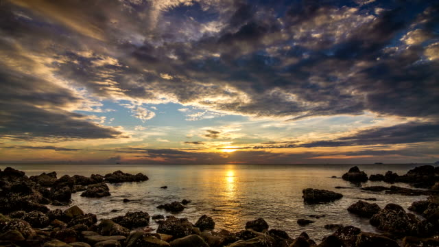 Sunset on sea in rocks bay time lapse video
