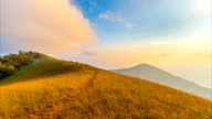 Sunset on the golden meadow mountain. Day to Night Timelapse video